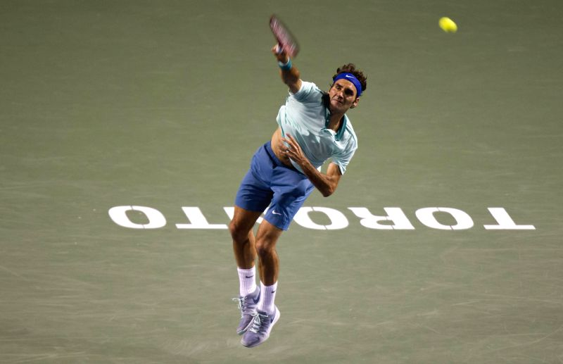 Roger Federer of Switzerland serves during the quarterfinal of men's singles against David Ferrer of Spain at the 2014 Rogers Cup in Toronto, Canada, Aug. 8, 2014. ..