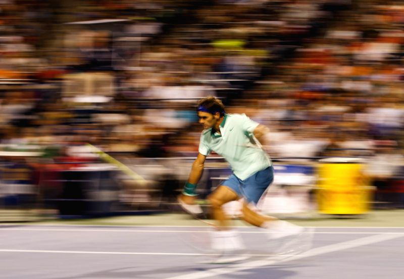Roger Federer of Switzerland returns the ball during the quarterfinal of men's singles against David Ferrer of Spain at the 2014 Rogers Cup in Toronto, Canada, Aug. .