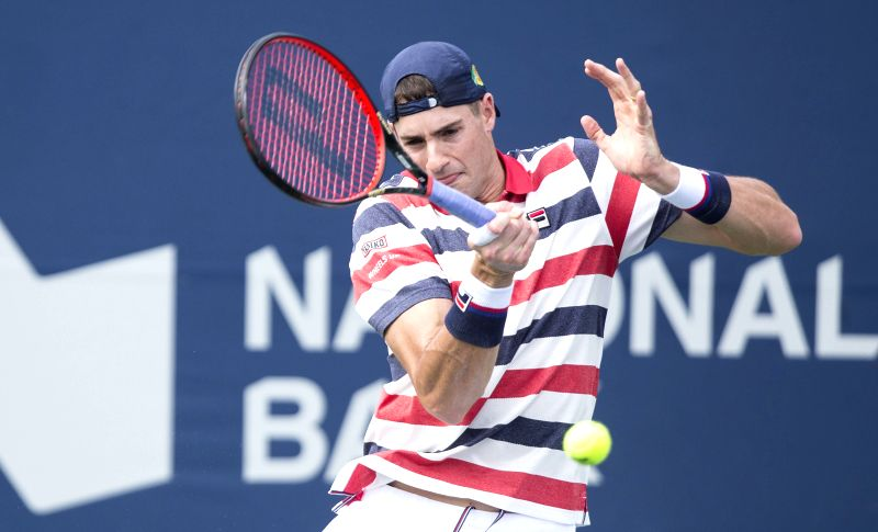 TORONTO, Aug. 9, 2018 - John Isner of the United States returns the ball to Pierre-Hugues Herbert of France during the second round of men's singles match at the 2018 Rogers Cup in Toronto, Canada, ...
