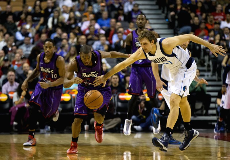 Toronto (Canada): Kyle Lowry(2nd L) of Toronto Raptors vies with Dirk Nowitzki (R) of Dallas Mavericks during their NBA game at Air Canada Center in Toronto, Canada, Nov. 28, 2014. Raptors lost ...