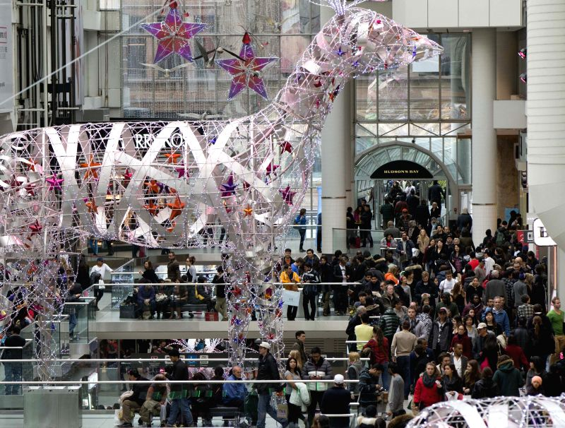 People shop at the Eaton Center on the Boxing Day in Toronto, Canada, Dec. 26, 2014. Boxing Day sales has become a tradition in Canada. During the day, many ...