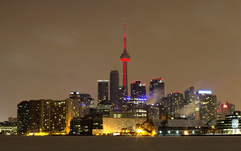 The CN Tower is lit up in red to celebrate the Chinese lunar New Year in Toronto, Canada, on Feb. 11, 2015.