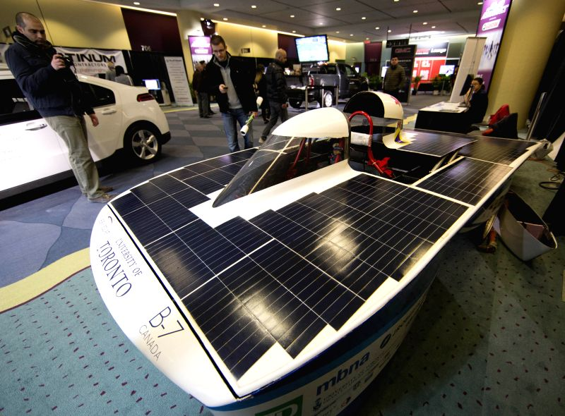 Visitors watch a solar vehicle during the 2015 Canadian International Auto Show at the Metro Toronto Convention Centre in Toronto, Canada, Feb. 17, 2015. ...