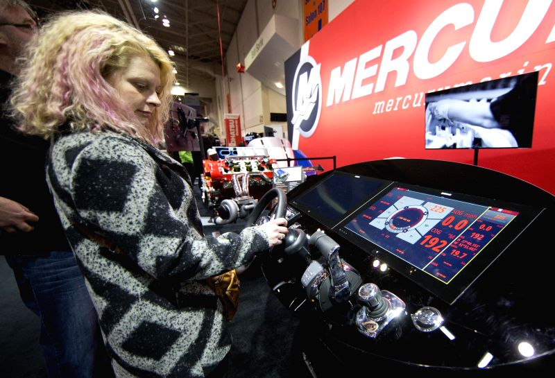 A woman examines a control panel model during the 57th Toronto International Boat Show at Exhibition Place in Toronto, Canada, Jan. 15, 2015. As one of the largest .