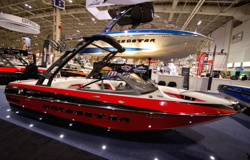 Visitors watch boats during the 57th Toronto International Boat Show at Exhibition Place in Toronto, Canada, Jan. 15, 2015. As one of the largest annual consumer ...