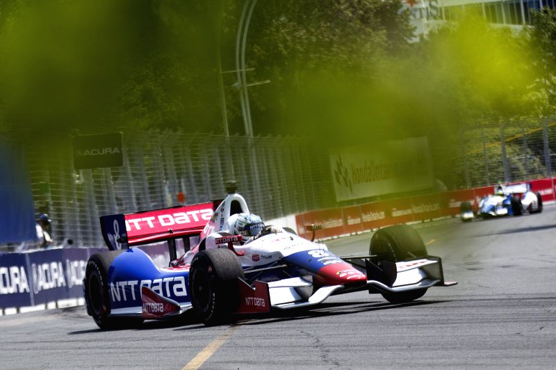 NTT Data Chip Ganassi Racing's Australian driver Ryan Briscoe drives during the practice session of the 2014 Honda Indy Toronto of IndyCar Series race in Toronto, ..
