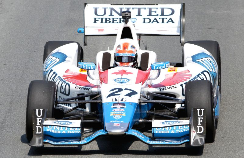 United Fiber & Data's Canadian driver James Hinchcliffe drives during the practice session of the 2014 Honda Indy Toronto of IndyCar Series race in Toronto, ...