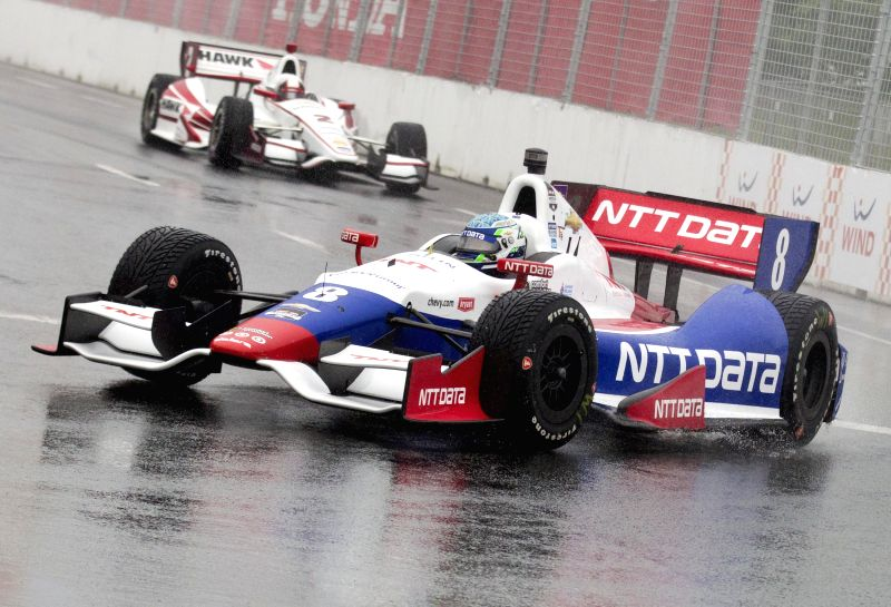 NTT Data Chip Ganassi Racing's Australian driver Ryan Briscoe (R) races during the 2014 Honda Indy Toronto of IndyCar Series race in Toronto, Canada, July 19, 2014. .