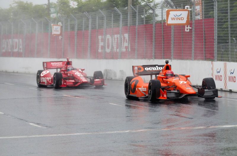 Schmidt Peterson Hamilton Motorsports' French driver Simon Pagenaud (R) races during the 2014 Honda Indy Toronto of IndyCar Series race in Toronto, Canada, July 19, .