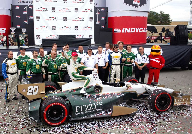 Ed Carpenter Racing's British driver Mike Conway (Front) celebrates victory during the award ceremony of the race two of the 2014 Honda Indy Toronto of IndyCar ...