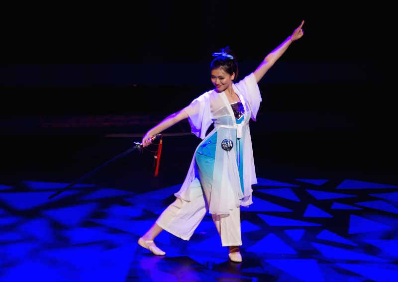 Contestant Clover Guo performs during the Miss Chinese Cosmos Pageant 2014 Toronto final at Markham Theater in Markham, Greater Toronto Area, Canada, July 21, 2014.