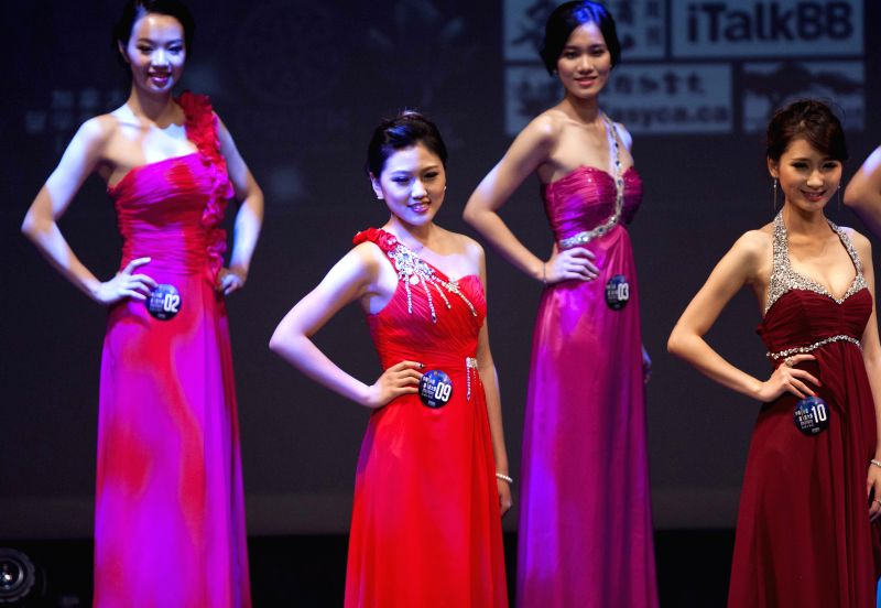 Contestant Yvonne Liu(2nd L) participates in the Miss Chinese Cosmos Pageant 2014 Toronto final at Markham Theater in Markham, Greater Toronto Area, Canada, July ...