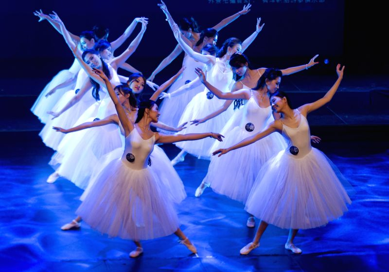 Contestants perform during the Miss Chinese Cosmos Pageant 2014 Toronto final at Markham Theater in Markham, Greater Toronto Area, Canada, July 21, 2014. York ...