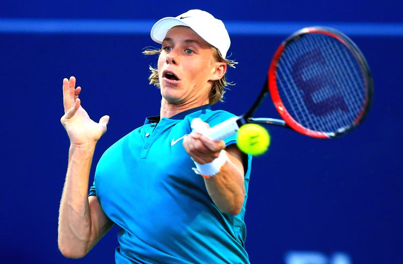 TORONTO, July 26, 2016 - Denis Shapovalov of Canada returns the ball against Nick Kyrgios of Australia during their first round of men's singles match at the 2016 Rogers Cup in Toronto, Canada, July ...