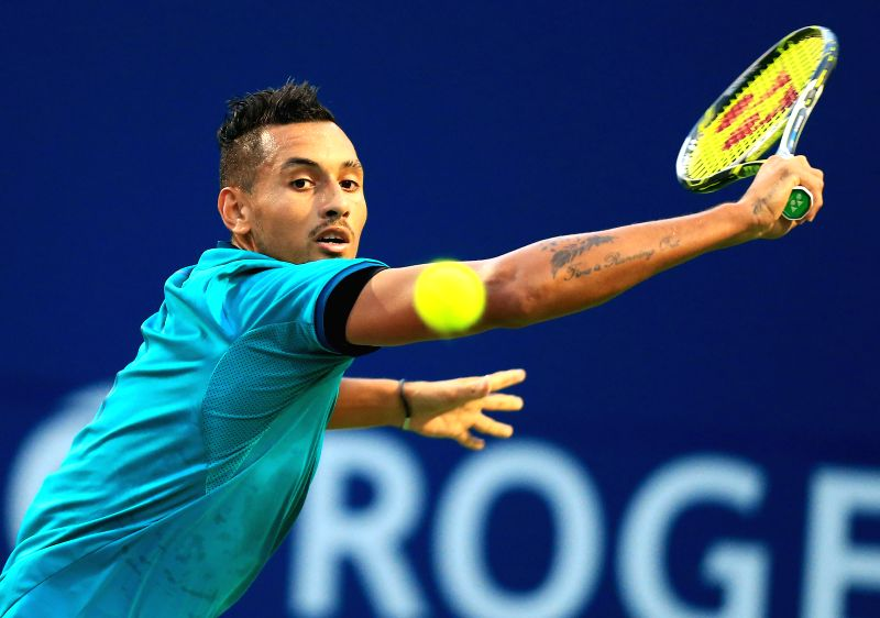 TORONTO, July 26, 2016 - Nick Kyrgios of Australia returns the ball against Denis Shapovalov of Canada during their first round of men's singles match at the 2016 Rogers Cup in Toronto, Canada, July ...