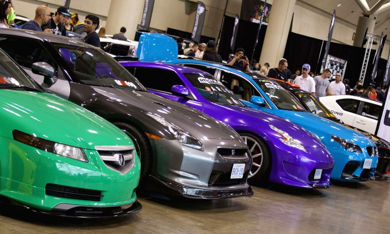 People watch tuned cars during the 2014 Importfest at Metro Toronto Convention Centre in Toronto, Canada, July 26, 2014. As the most recognized events in Canadian ..