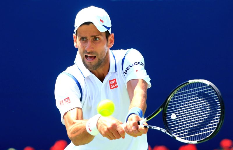 TORONTO, July 28, 2016 - Novak Djokovic of Serbia returns the ball against Gilles Muller of Luxembourg during their second round of men's singles match at the 2016 Rogers Cup in Toronto, Canada, July ...