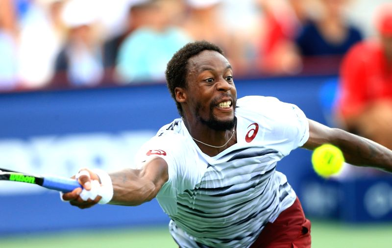 TORONTO, July 29, 2016 - Gael Monfils of France returns the ball against David Goffin of Belgium during their third round of men's singles match at the 2016 Rogers Cup in Toronto, Canada, July 28, ...