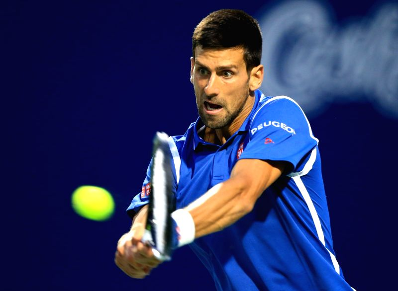 TORONTO, July 29, 2016 - Novak Djokovic of Serbia returns the ball against Radek Stepanek of the Czech Republic during their third round of men's singles match at the 2016 Rogers Cup in Toronto, ...
