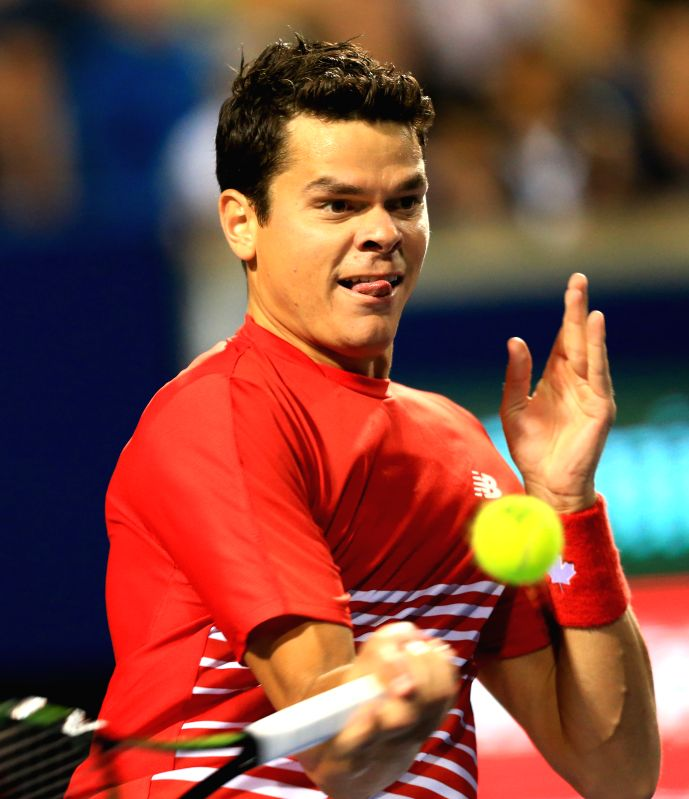 TORONTO, July 30, 2016 - Milos Raonic of Canada returns the ball against Gael Monfils of France during the quarterfinal match of men's singles at the 2016 Rogers Cup in Toronto, Canada, July 29, ...