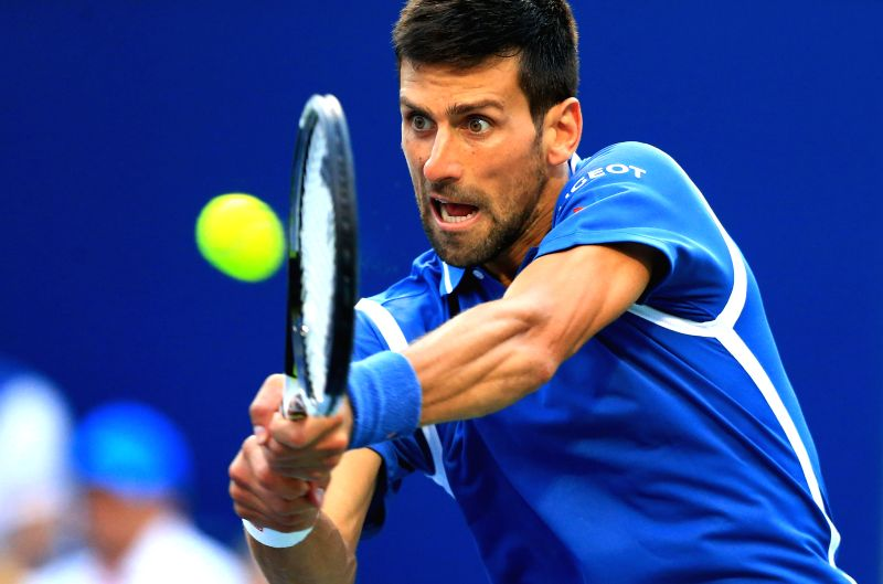 TORONTO, July 30, 2016 - Novak Djokovic of Serbia returns the ball against Tomas Berdych of the Czech Republic during their quarterfinal match of men's singles at the 2016 Rogers Cup in Toronto, ...