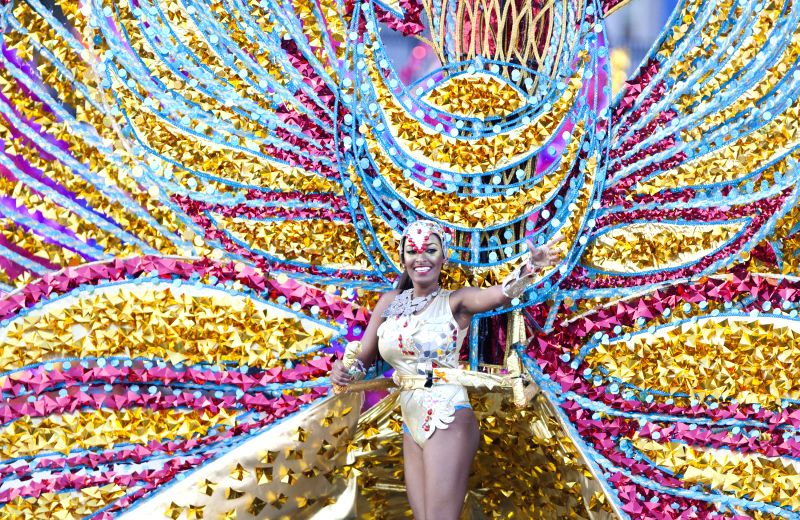 A dressed up competitor perfroms with her float during the King and Queen Competition and Show of the 2015 Toronto Caribbean Carnival in Toronto, Canada, July 30, ...