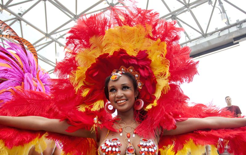 A reveller attends the official launch of the 47th annual Toronto Caribbean Carnival at the Nathan Phillips Square in Toronto, Canada, July 8, 2014. The three-week ..