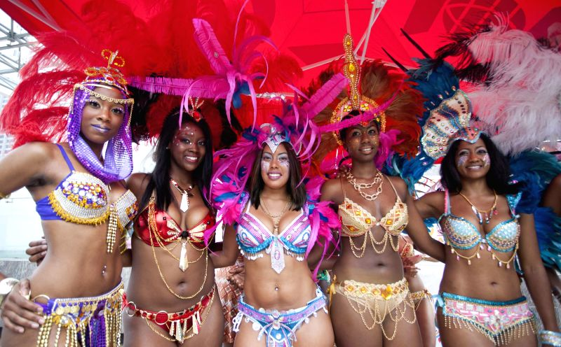 Revellers attend the official launch of the 47th annual Toronto Caribbean Carnival at the Nathan Phillips Square in Toronto, Canada, July 8, 2014. The three-week ...