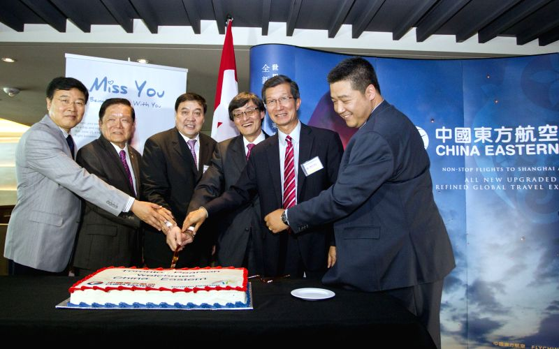 China Eastern Airlines Vice President Tian Liuwen (3rd L), Canada Greater Toronto Airports Authority President and CEO Howard Eng (3rd R) and Chinese Consul General