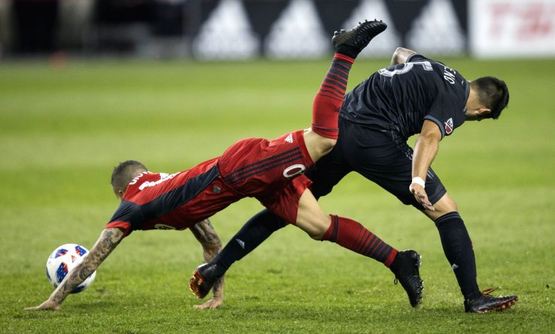 TORONTO, June 14, 2018 - Sebastian Giovinco (L) of Toronto FC vies with Junior Moreno of D.C. United during their 2018 Major League Soccer (MLS) match at BMO Field in Toronto, Canada, June 13, 2018. ...