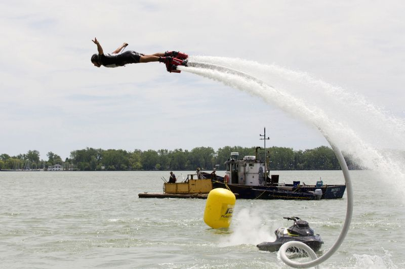 A flyboard rider performs with a water-propelled flyboard which connects to a personal motorboat with a hose during the 2014 Flyboard North American Championships in