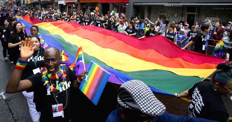 TORONTO, June 25, 2018 (Xinhua) -- People take part in the 2018 Toronto Pride Parade in Toronto, Canada, June 24, 2018. (Xinhua/Zou Zheng/IANS)