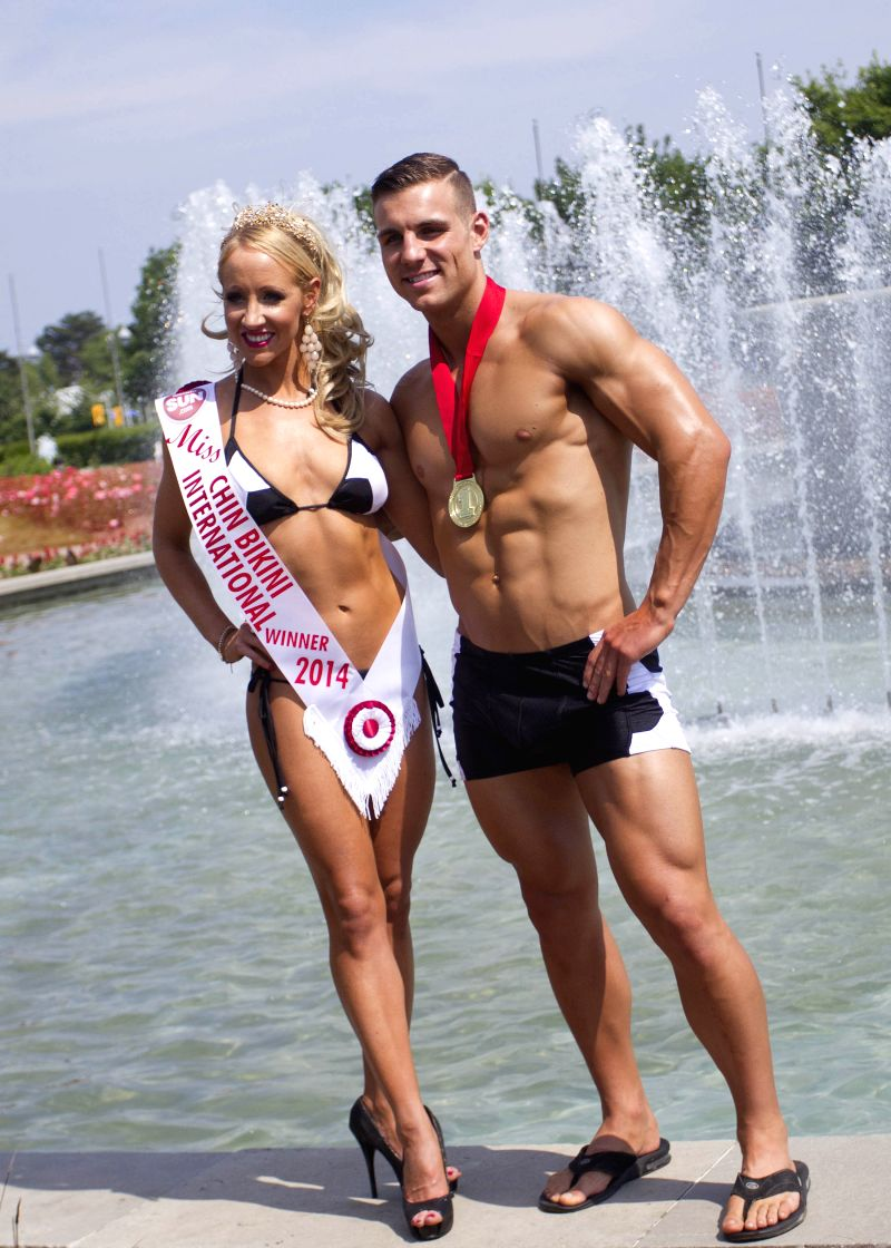 Contestants pose on stage during the 2014 Toronto Miss Chin Bikini and Mr. Chin Bikini Contest in Toronto, Canada, June 28, 2014. 28-year-old Jennifer Thiessen won .