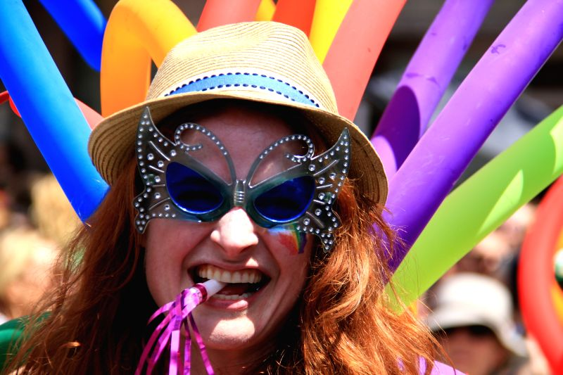 A dressed up reveller poses for photos during the WorldPride 2014 Toronto Parade in Toronto, Canada, June 29, 2014. More than 12,000 marchers took part in this ...