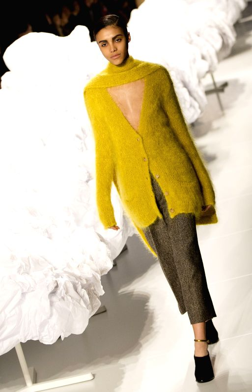 A model walks the runway wearing Pink Tartan fall 2015 collection during the first day of the World MasterCard Toronto Fashion Week Fall 2015 in Toronto, Canada, ...