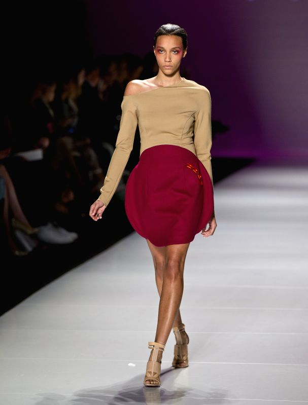 A model presents a creation of Vawk fall 2015 collection during the World MasterCard Toronto Fashion Week Fall 2015 at David Pecaut Square in Toronto, Canada, ...