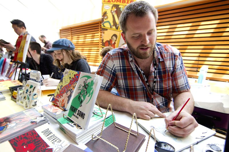 Comic creators display and sale their works during the 2014 Toronto Comic Arts Festival in Toronto, Canada, May 10, 2014. Focusing on readings, presentations and ...