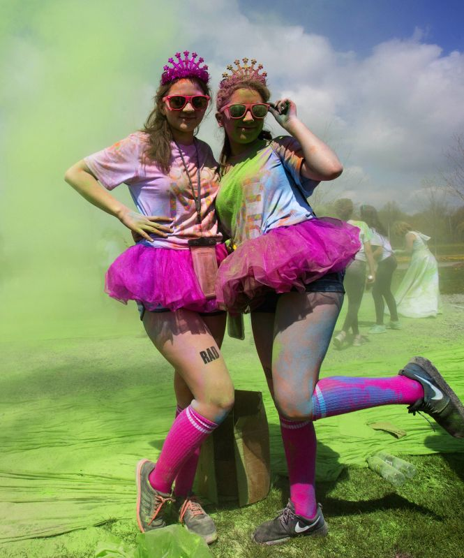 TORONTO, May 13, 2017 - Twin sisters pose for photos during the 2017 Color Me Rad 5K Run event at Downsview Park in Toronto, Canada, May 13, 2017. Thousands of people participated in this annual ...