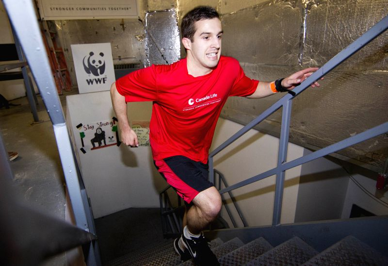 A participant climbs Canada's National Tower during the 2014 WWF Canada's National Tower Climb event in Toronto, Canada, on May 1, 2014.  More than 5,000 participants
