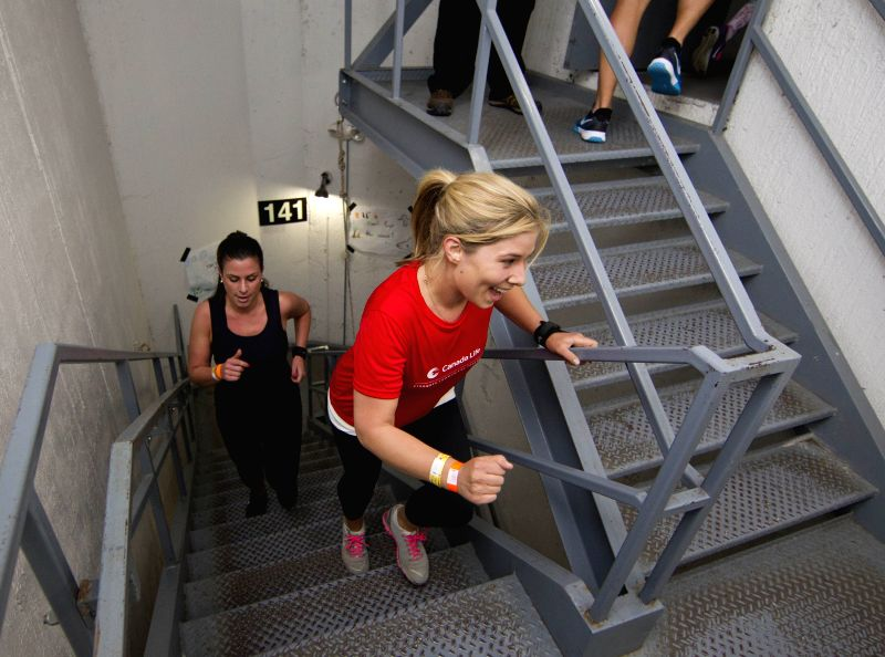 Participants climb Canada's National Tower during the 2014 WWF Canada's National Tower Climb event in Toronto, Canada, on May 1, 2014.  More than 5,000 participants ..