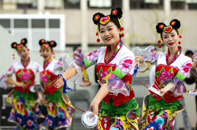 TORONTO, May 20, 2017 - Dancers from Sichuan Research Institute of Chinese Folk Vocal Art Forms perform during the 2017 China Culture and Tourism Festival at Nathan Phillips Square in Toronto, ...