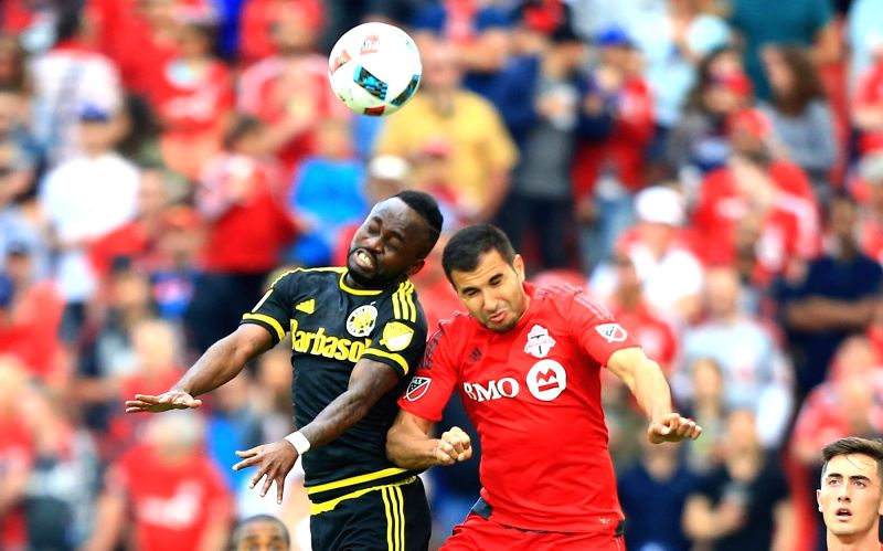 TORONTO , May 22, 2016 - Steven Beitashour(C) of Toronto FC vies with Cedrick Mabwati(L) of Columbus Crew SC during the 2016 Major League Soccer (MLS) match in Toronto, Canada, May 21, 2016. The ...