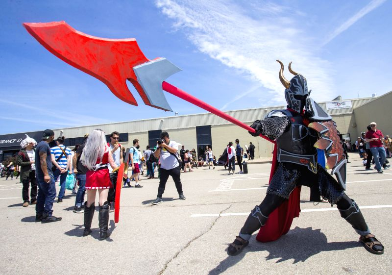 TORONTO, May 28, 2017 - A cosplayer poses for photos during the 2017 Anime North at the Toronto Congress Center in Toronto, Canada, on May 28, 2017. The three-day annual event kicked off on Friday to ...