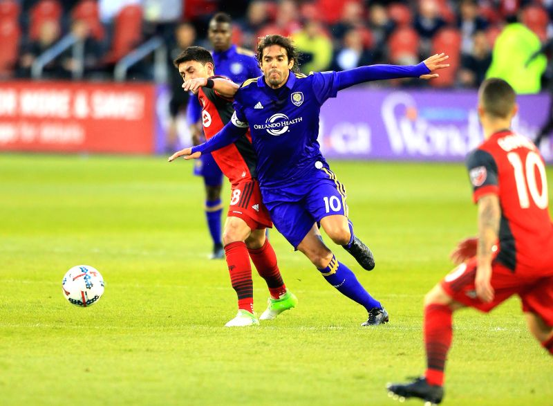 TORONTO, May 4, 2017 - Marco Delgado (L) of Toronto FC vies with Kaka (2nd R) of Orlando City SC during their 2017 Major League Soccer (MLS) match at BMO Field in Toronto, Canada, May 3, 2017. ...