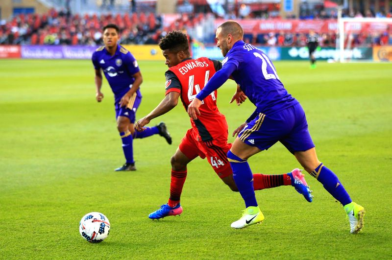 TORONTO, May 4, 2017 - Raheem Edwards (C) of Toronto FC breaks through during the 2017 Major League Soccer (MLS) match between Toronto FC and Orlando City SC at BMO Field in Toronto, Canada, May 3, ...