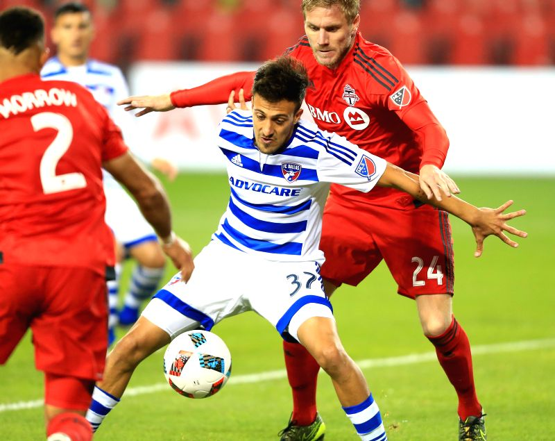 TORONTO, May 8, 2016 - Damien Perquis (1st R) of Toronto FC vies with Maximiliano Urruti (2nd R) of FC Dallas during their 2016 Major League Soccer (MLS) match in Toronto, Canada, May 7, 2016. ...