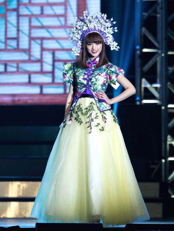 TORONTO, Nov. 25, 2017 - Contestant Cynthia Fu poses on stage during the 2017 Miss Chinese Toronto Pageant final in Toronto, Canada, Nov. 24, 2017. Tiffany Choi, 23 years old, was crowned the 2017 ...