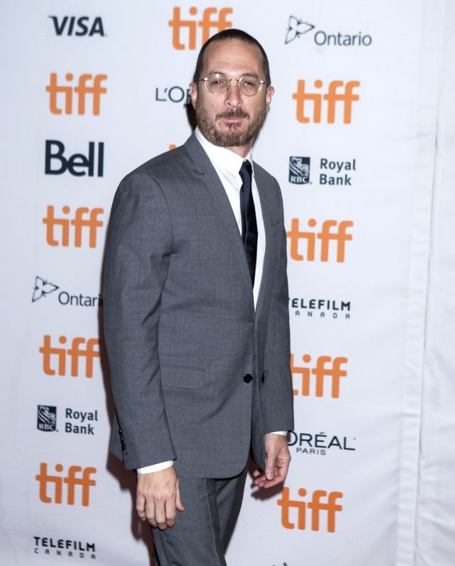 "TORONTO, Sept. 11, 2017 - Director Darren Aronofsky poses for photographs at the North American premiere of the film ""Mother!"" at Princess of Wales Theatre during the 2017 Toronto ..."