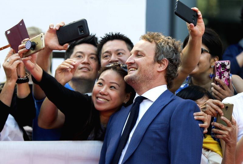 """TORONTO, Sept. 13, 2017 - Actor Jason Clarke poses for photographs with fans at the international premiere of the film """"Mudbound"""" at Roy Thomson Hall during the 2017 Toronto International ... - Jason Clarke"""