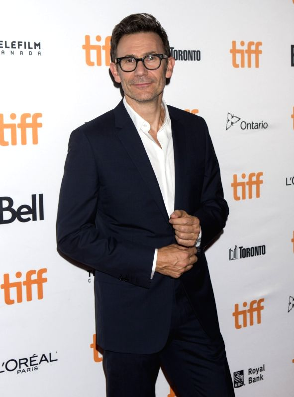 """TORONTO, Sept. 15, 2017 - Director Michel Hazanavicius poses for photographs at the North American premiere of the film """"Redoubtable"""" at Elgin Theatre during the 2017 Toronto International ..."""
